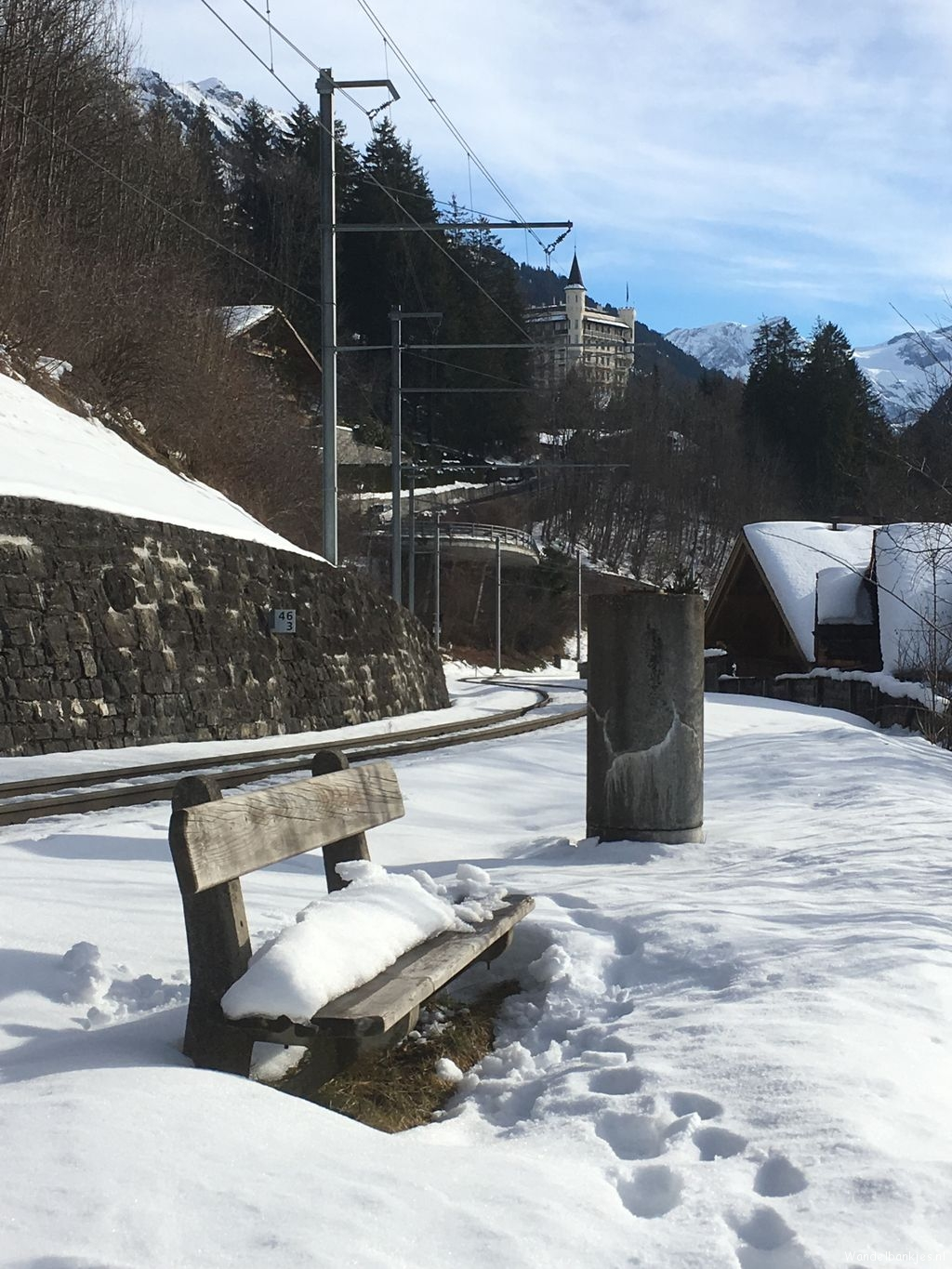 rt-huusgstaadhotel-walking-benches-on-this-bench-with-the-characteristic-palace-hotel-on-the-background-look-out-about-gstaad-https-tc